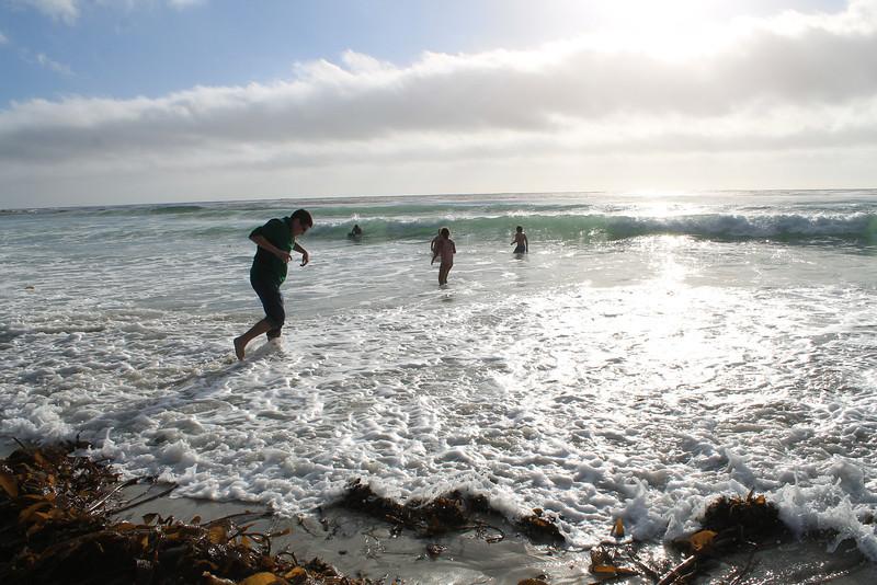 Daniel's inaugural toe dip in the Pacific Ocean.