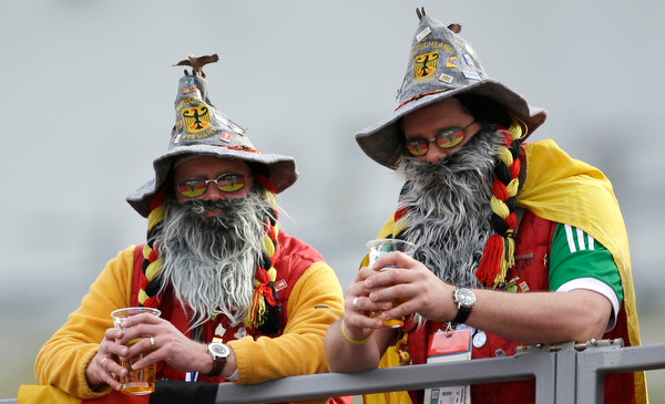 . Germany fans watch the ski jumping portion of the Nordic combined Gundersen large hill team competition at the 2014 Winter Olympics, Thursday, Feb. 20, 2014, in Krasnaya Polyana, Russia. (AP Photo/Gregorio Borgia)