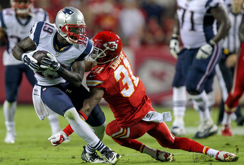 . New England Patriots wide receiver Brandon LaFell, left, slips past Kansas City Chiefs cornerback Marcus Cooper after catching a pass and running it 44 yards for a touchdown during the third quarter of an NFL football game Monday, Sept. 29, 2014, in Kansas City, Mo. (AP Photo/Ed Zurga)