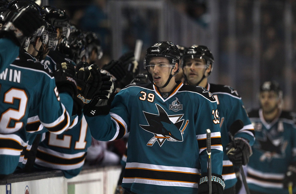 . SAN JOSE, CA - JANUARY 24:  Logan Couture #39 of the San Jose Sharks is congratulated by teammates after he scored a powerplay goal in the first period of their game against the Phoenix Coyotes at HP Pavilion on January 24, 2013 in San Jose, California.  (Photo by Ezra Shaw/Getty Images)