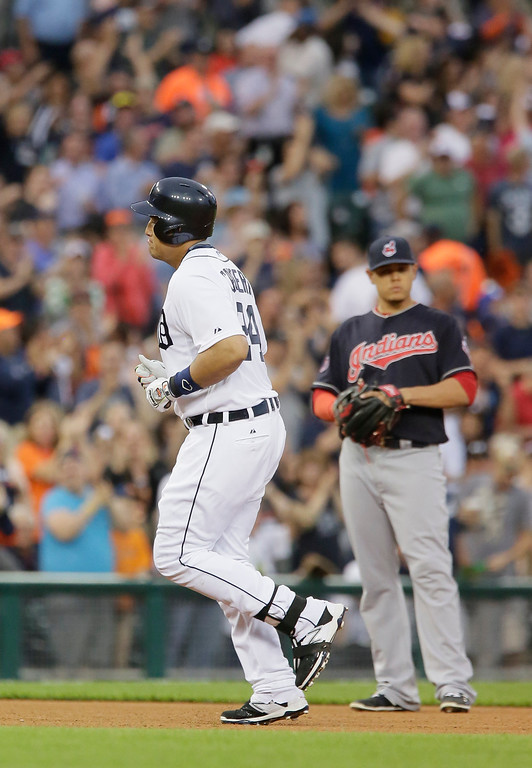 . Detroit Tigers\' Miguel Cabrera rounds the bases past Cleveland Indians third baseman Giovanny Urshela, right, after hitting a three-run home run during the sixth inning of a baseball game Friday, June 12, 2015, in Detroit. (AP Photo/Duane Burleson)