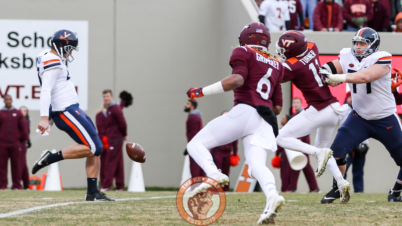 Tre Turner and Hezekiah Grimsley get close to blocking a UVa punt in the first quarter. (Mark Umansky/TheKeyPlay.com)