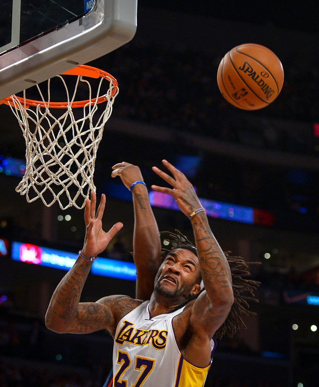 . Lakers� Jordan Hill tries for a rebound during first half action at Staples Center Sunday, November 17, 2013.  ( Photo by David Crane/Los Angeles Daily News )