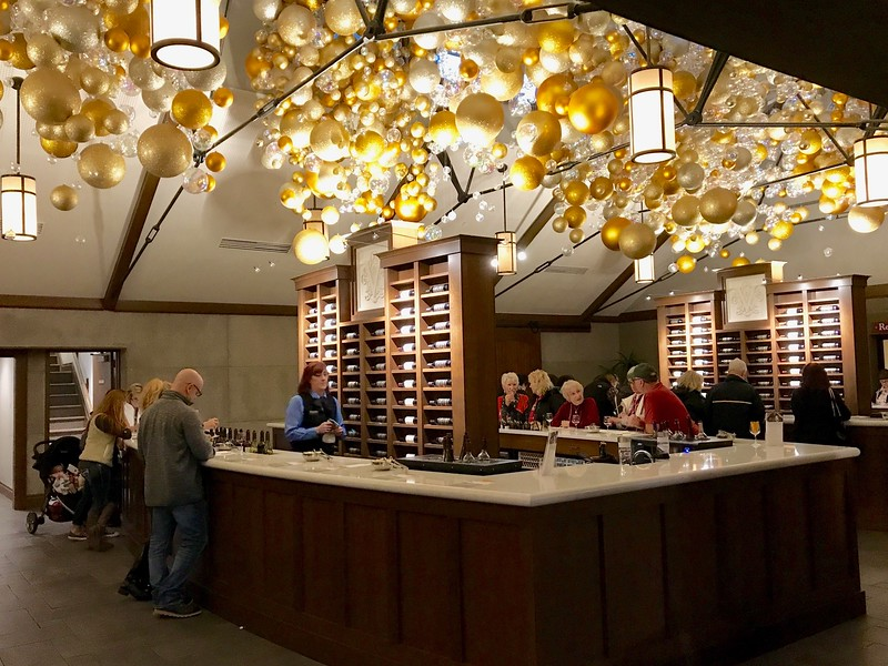 a large room with bar and wine racks