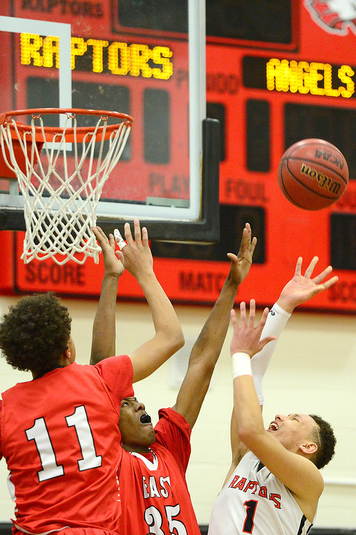 . CENTENNIAL, CO - MARCH 2: Kwane Marble (11) and Daytone Jennings (35) of Denver East try to defend a shot from Colbey Ross (1) of Eaglecrest during the fourth quarter at Eaglecrest High School on March 2, 2016 in Centennial, Colorado. Eaglecrest defeated Denver East 56-46. (Photo by Brent Lewis/The Denver Post)