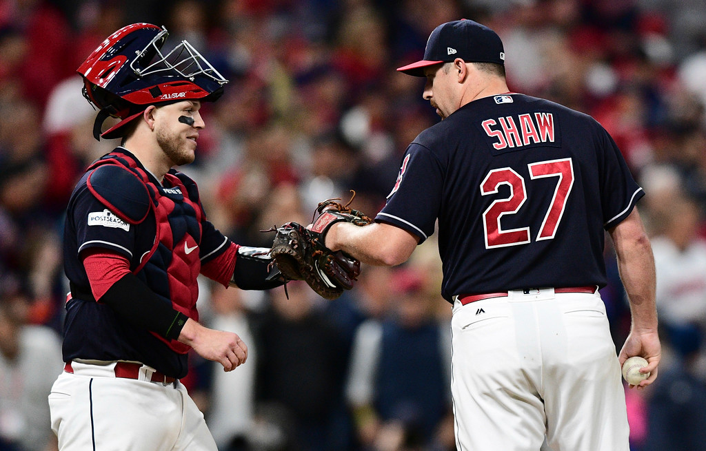. Cleveland Indians relief pitcher Bryan Shaw is congratulated by catcher Roberto Perez before being relieved from the game in the eighth inning of Game 5 of baseball\'s American League Division Series, Wednesday, Oct. 11, 2017, in Cleveland. (AP Photo/David Dermer)