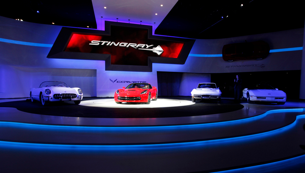 . The 2014 Chevrolet Corvette Stingray, second from left, is shown at media previews for the North American International Auto Show in Detroit, Monday, Jan. 14, 2013.  (AP Photo/Paul Sancya)