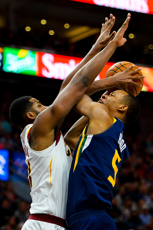 . Cleveland Cavaliers center Tristan Thompson, left, attempts to block Utah Jazz guard Rodney Hood, right, in the second half of an NBA basketball game Saturday, Dec. 30, 2017, in Salt Lake City. (AP Photo/Alex Goodlett)