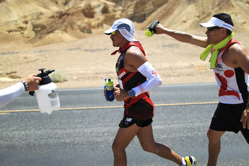 . Oswaldo Lopez of Madera, California is cooled by his crew as he runs in the AdventurCORPS Badwater 135 ultra-marathon race on July 15, 2013 in Death Valley National Park, California. Billed as the toughest footrace in the world, the 36th annual Badwater 135 starts at Badwater Basin in Death Valley, 280 feet below sea level, where athletes begin a 135-mile non-stop run over three mountain ranges in extreme mid-summer desert heat to finish at 8,350 feet above sea level near Mount Whitney for a total cumulative vertical ascent of 13,000 feet. July 10 marked the 100-year anniversary of the all-time hottest world record temperature of 134 degrees, set in Death Valley where the average high in July is 116. A total of 96 competitors from 22 nations are attempting the run which equals about five back-to-back marathons. Previous winners have completed all 135 miles in slightly less than 24 hours.  (Photo by David McNew/Getty Images)