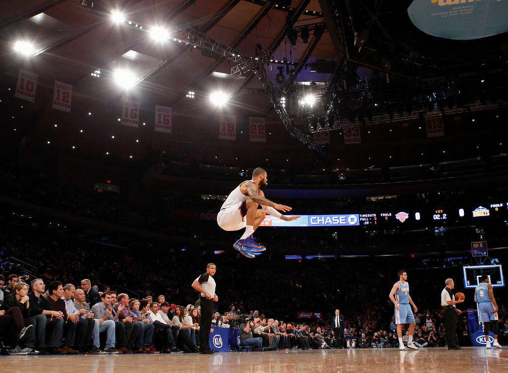 . New York Knicks center Tyson Chandler jumps to warm up prior to the tip off against the Denver Nuggets in their NBA basketball game at Madison Square Garden in New York, December 9, 2012. REUTERS/Adam Hunger