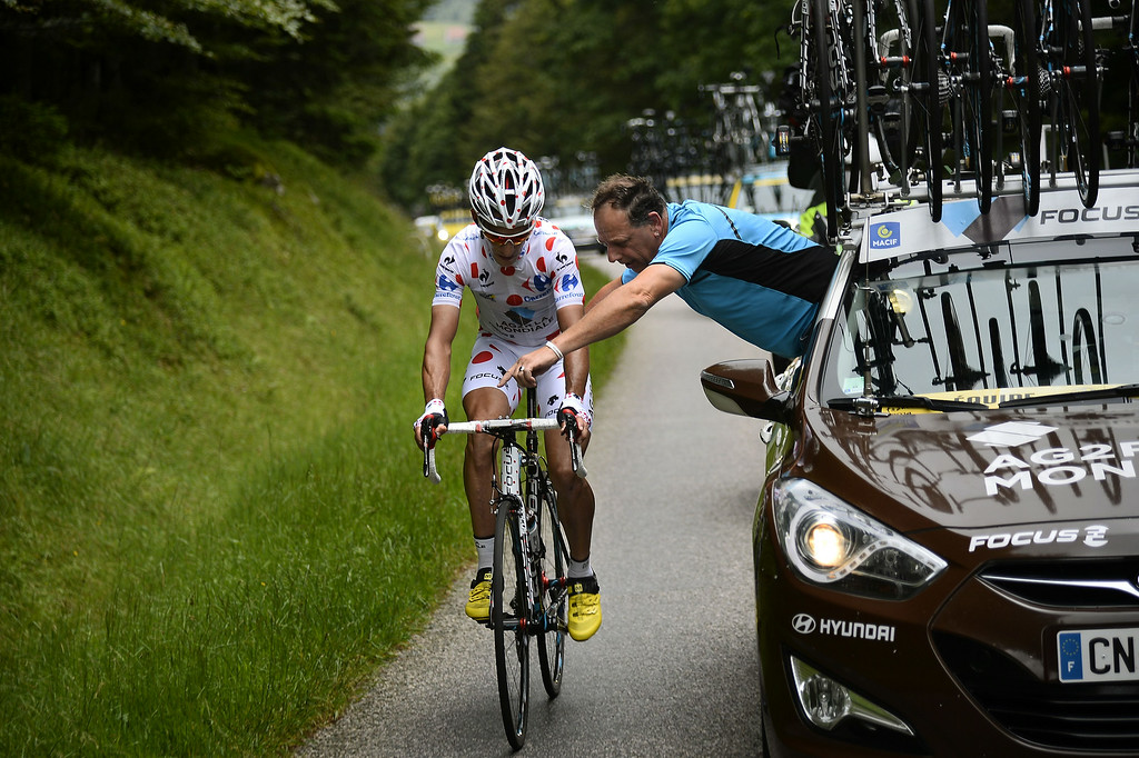 . France\'s Blel Kadri receives assistance from the team mechanic during the 170 km ninth stage of the 101st edition of the Tour de France cycling race on July 13, 2014 between Gerardmer and Mulhouse, eastern France.  LIONEL BONAVENTURE/AFP/Getty Images