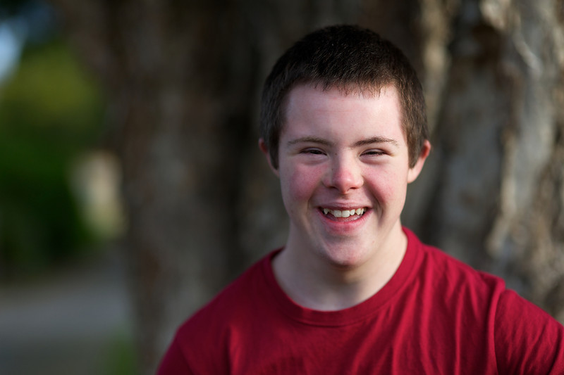 Smiling teenage boy shot with a narrow depth of field