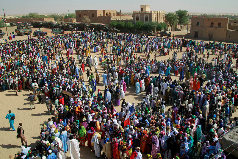 . Well-wishers gather to greet French President Francois Hollande during his two-hour-long visit to Timbuktu, Mali, Saturday Feb. 2, 2013.(AP Photo/Jerome Delay)