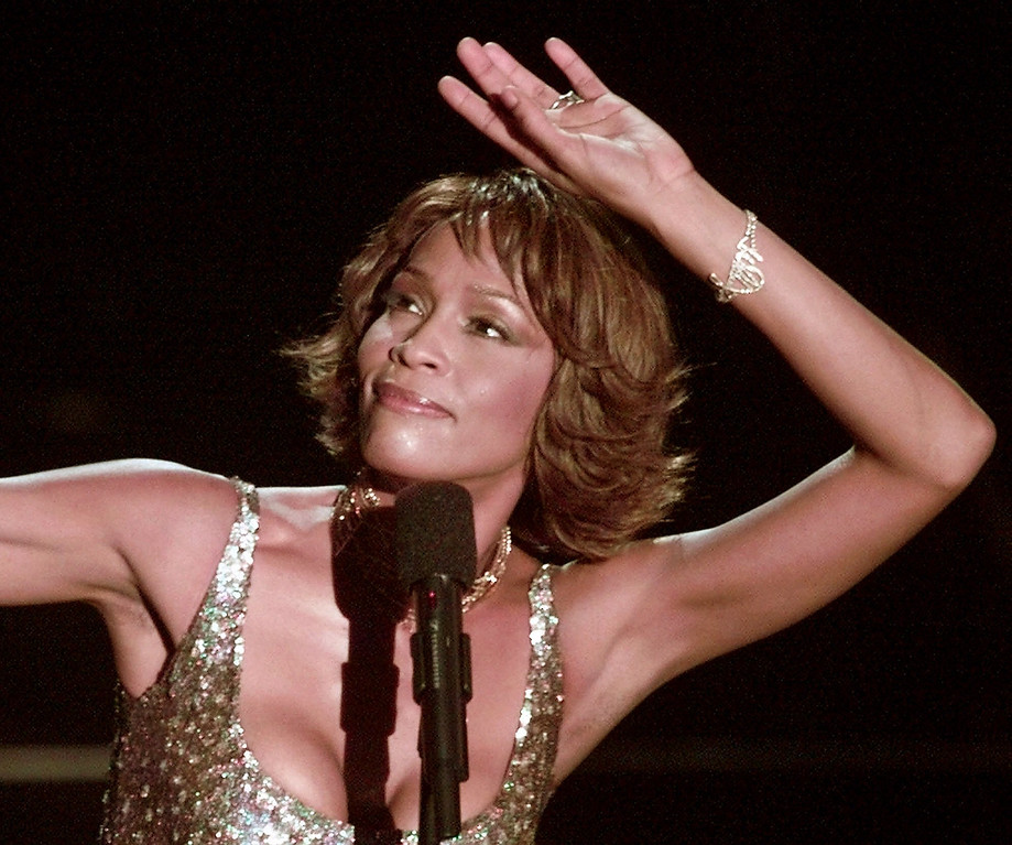 ". File - Entertainer Whitney Houston strikes a pose during her performance at the Shrine Auditorium in Los Angeles, Monday, April 10, 2000,  during taping of the ""25 Years of #1 Hits: Arista Records\' Anniversary Celebration.\""   (AP Photo/Mark J. Terrill)"