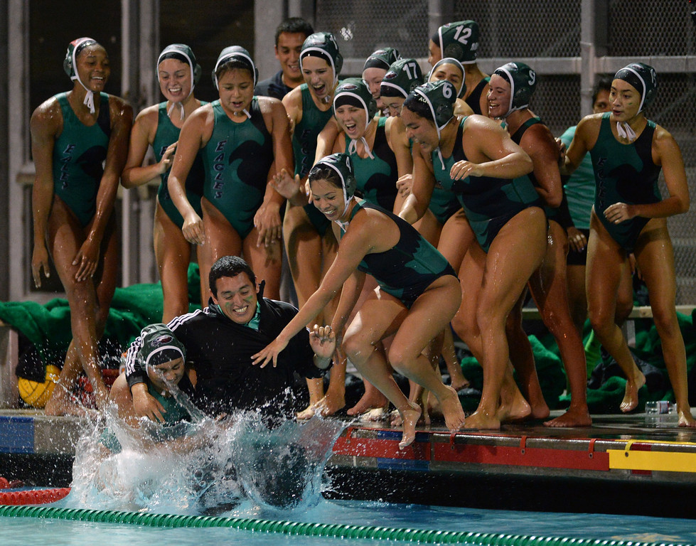 . Eagle Rock coach Andres Gonzalez is thrown in to the pool by players after beating Palisades to win the City Section girls water polo final at the Contreras Learning Complex in Los Angeles Thursday, February 27, 2014. (Photo by Hans Gutknecht/Los Angeles Daily News)