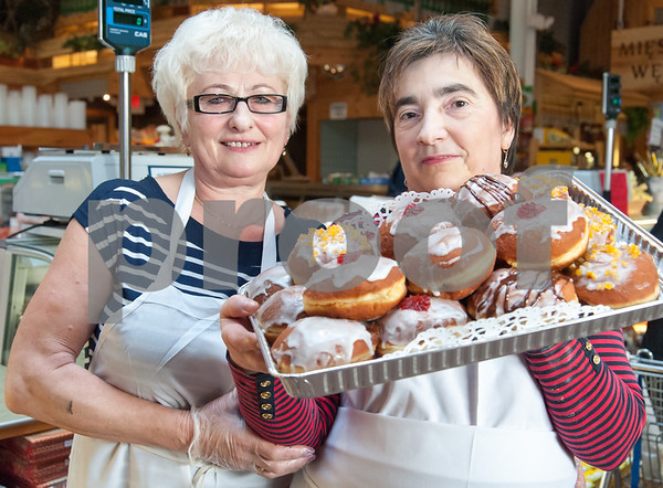 02/06/18 Wesley Bunnell | Staff Teresa Hummienna, L, and Grazyna Labay hold a tray of freshly prepared paczki at Roly Poly Bakery on Tuesday afternoon.