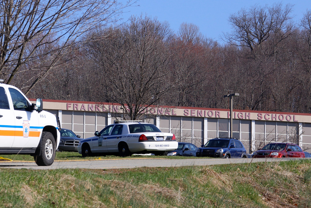 . Emergency vehicles are parked around Franklin Regional High School, where several people were stabbed on Wednesday, April 9, 2014, in Murrysville, Pa., near Pittsburgh. The suspect, a male student, was taken into custody and being questioned. (AP Photo/Gene Puskar)
