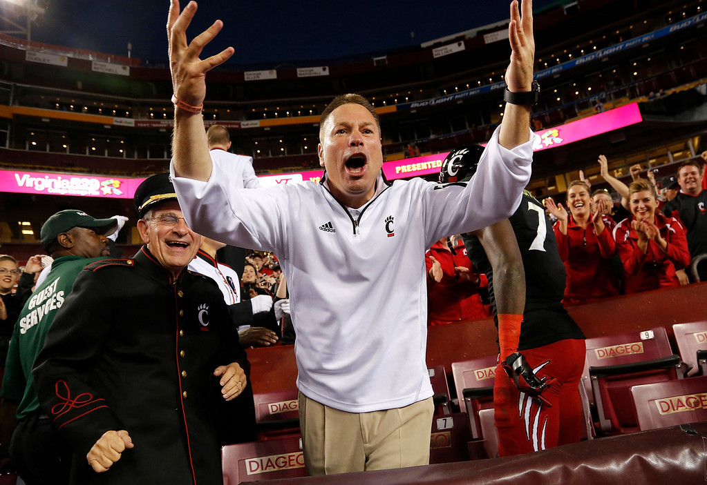 . LANDOVER, MD - SEPTEMBER 29: Head coach Butch Jones of the Cincinnati Bearcats directs his player to sing along with the marching band after they defeated the Virginia Tech Hokies 27-24 at FedExField on September 29, 2012 in Landover, Maryland. (Photo by Jonathan Ernst/Getty Images)