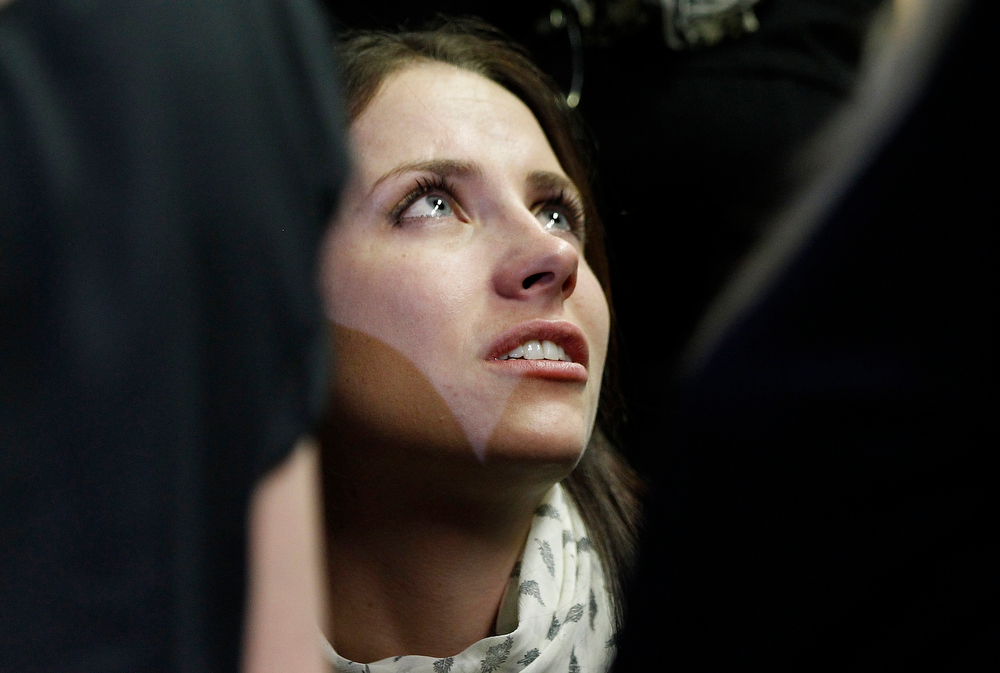 Description of . Oscar Pistorius's sister Aimee reacts at the end of his court appearance in the Pretoria Magistrates court February 19, 2013. Pistorius, a double amputee who became one of the biggest names in world athletics, was applying for bail after being charged in court with shooting dead his girlfriend, 30-year-old model Reeva Steenkamp, in his Pretoria house. REUTERS/Siphiwe Sibeko