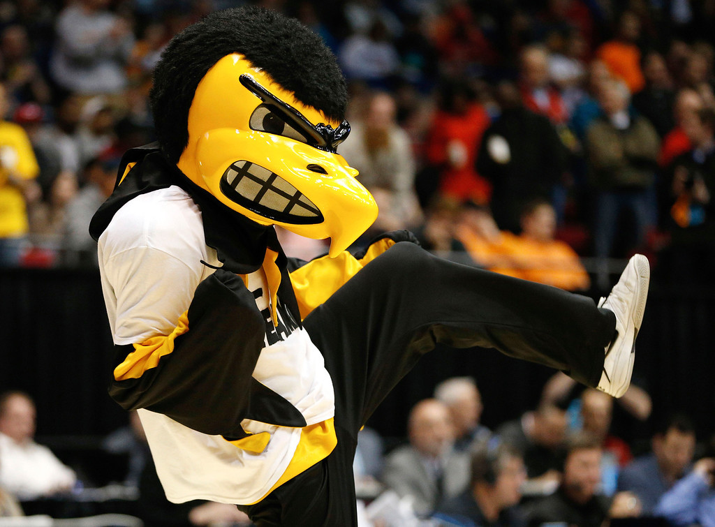 . The Iowa Hawkeyes mascot, Herky, performs during the first round of the 2014 NCAA Men\'s Basketball Tournament against the Tennessee Volunteers at UD Arena on March 19, 2014 in Dayton, Ohio.  (Photo by Gregory Shamus/Getty Images)