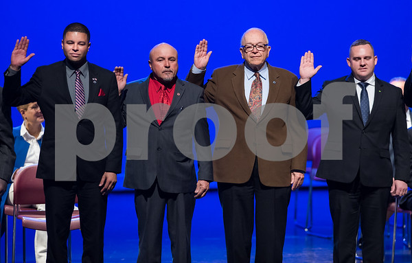 11/14/17 Wesley Bunnell | Staff The inauguration of Mayor Erin E. Stewart and other elected officials was held on Tuesday morning at New Britain High School. Common Council members Kristian Rosado, Wilfredo Pabon, Don Naples and Robert Smedley take the oath.