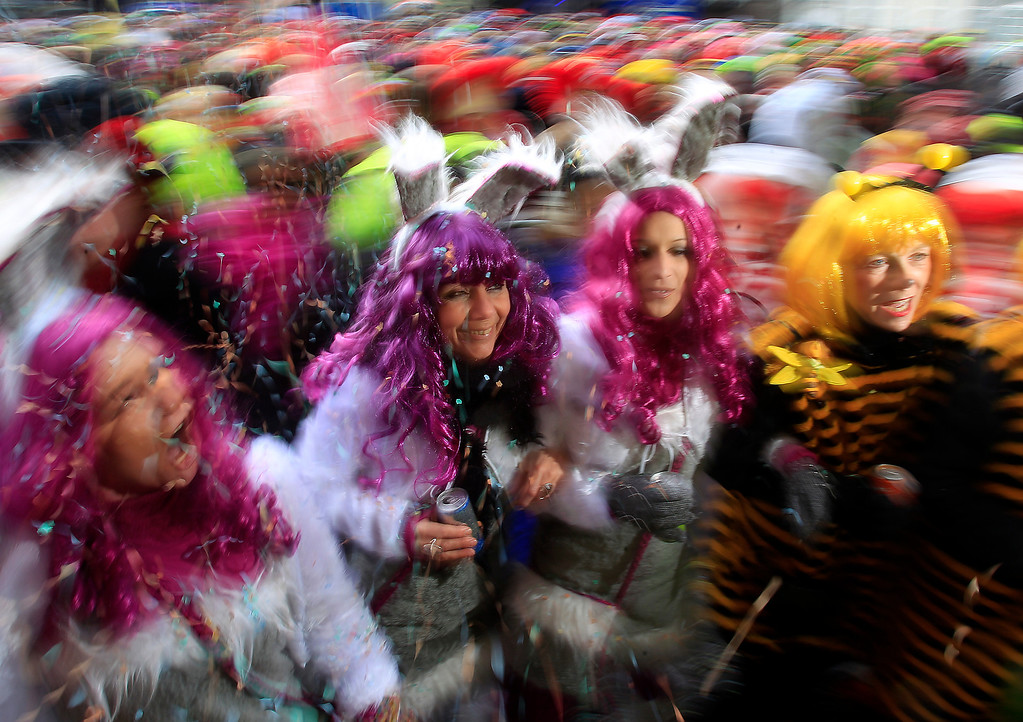 ". Revelers dressed in carnival costumes celebrate the start of the street-carnival with its tradition of entering the town halls and women cutting off men\'s ties with scissors on carnival\'s so called ""Old Women\'s Day\"" in Duesseldorf, Germany, Thursday, Feb. 27, 2014.(AP Photo/Frank Augstein)"