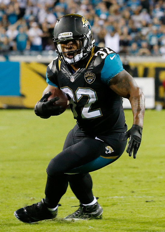 . Maurice Jones-Drew #32 of the Jacksonville Jaguars rushes for yardage during the game against the Houston Texans at EverBank Field on December 5, 2013 in Jacksonville, Florida.  (Photo by Sam Greenwood/Getty Images)