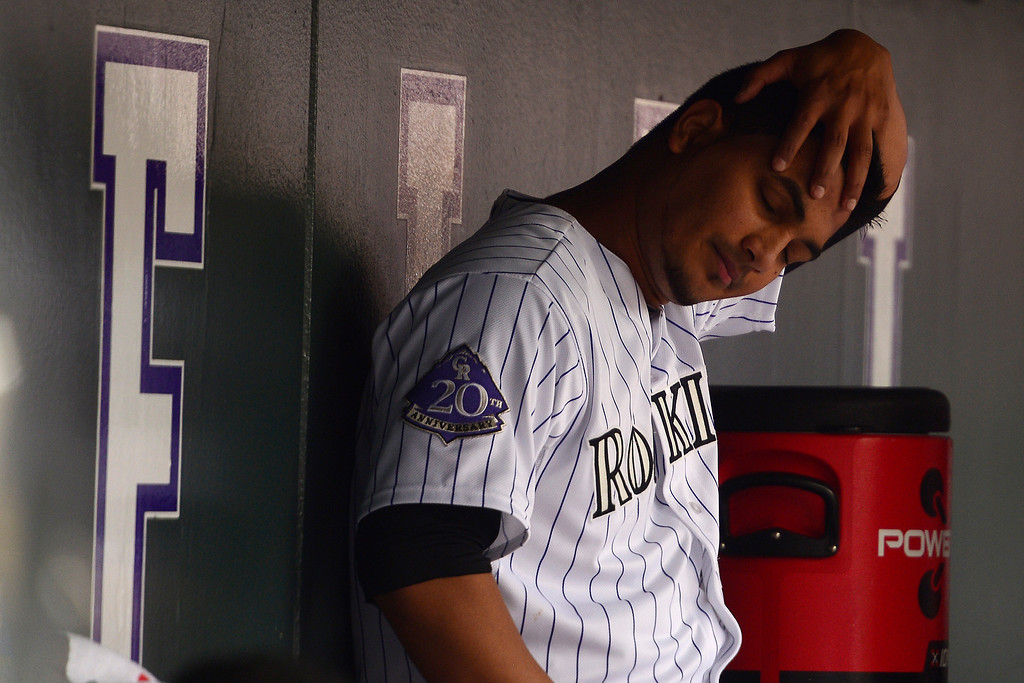 . DENVER, CO - MAY 5: Jhoulys Chacin (45) of the Colorado Rockies stretches in the dugout against the Tampa Bay Rays during the Rockies 8-3 loss.   (Photo by AAron Ontiveroz/The Denver Post)