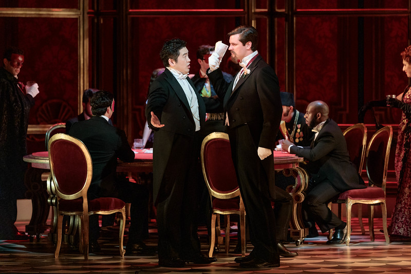 "Kang Wang as Alfredo, Jonathan Bryan as Baron Douphol and members of the ensemble in The Glimmerglass Festival's 2019 production of ""La traviata."" Photo: Karli Cadel/The Glimmerglass Festival"