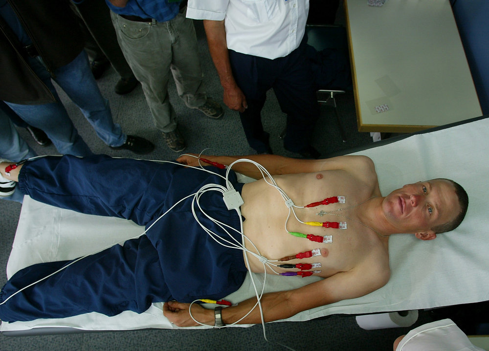 Description of . Three-time Tour de France winner Lance Armstrong of Austin, Texas, undergoes medical examinations ahead of the Tour de France cycling race in Luxembourg, Thursday, July 4, 2002. The 21-stage Tour will start in Luxembourg on Saturday July 6, 2002, to end in Paris on July 28. (AP Photo/Laurent Rebours/Pool)