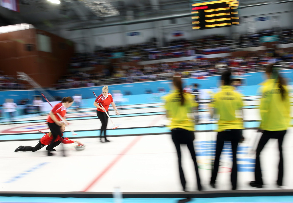 . Lene Nielsen (L) of Denmark throws a stone, as Korean team watches during the Round Robin match between Denmark and Korea in the Women\'s Curling Competition in the Ice Cube Curling Center at the Sochi 2014 Olympic Games, Sochi, Russia. EPA/TATYANA ZENKOVICH