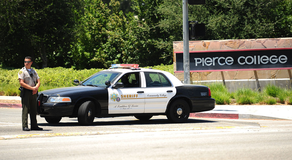 . Sheriff deputy blocks an entrance at Pierce College May 30, 2014 in Woodland Hills.  A report of a suicidal man with a gun on campus created a lockdown situiation around noon.  The man was later found at Canoga Bowl.(Andy Holzman/Los Angeles Daily News)