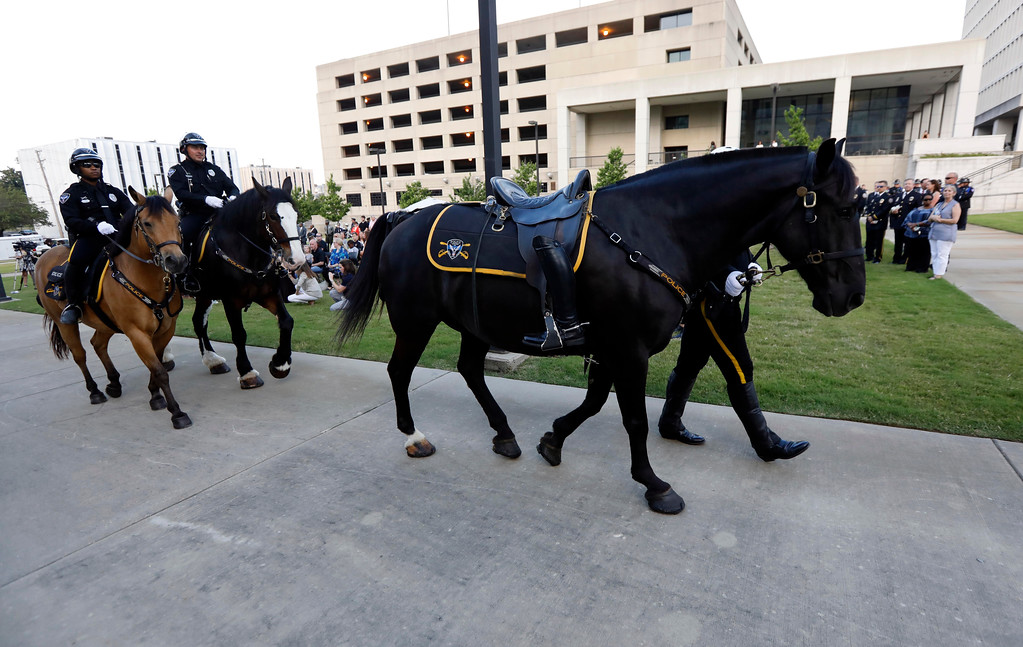 . A lawman\'s riderless horse passes review during the Mississippi Law Enforcement Memorial Candlelight Vigil by the Statewide Fallen Officers Memorial in Jackson, Miss., Tuesday, May 15, 2018. (AP Photo/Rogelio V. Solis)