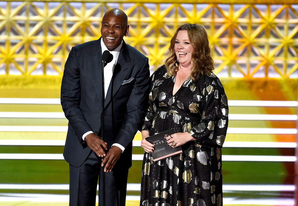 . Dave Chappelle, left, and Melissa McCarthy present the award for outstanding directing for a comedy series at the 69th Primetime Emmy Awards on Sunday, Sept. 17, 2017, at the Microsoft Theater in Los Angeles. (Photo by Chris Pizzello/Invision/AP)