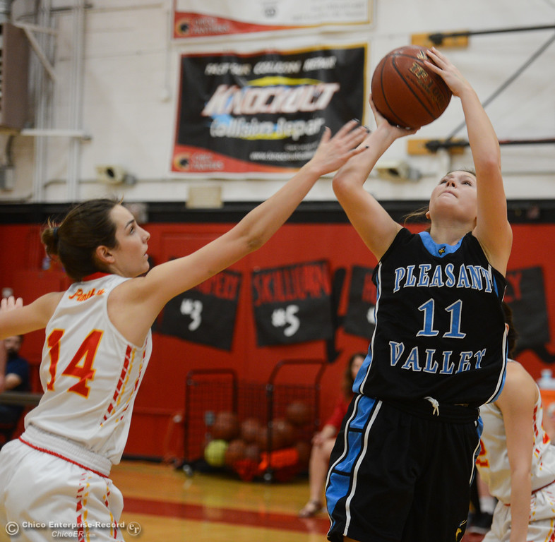 . Pleasant Valley\'s Olivia Layne (11) goes up for a shot against Chico High\'s Savannah Wahl (14), Thursday, February 8, 2018, in Chico, California. (Carin Dorghalli -- Enterprise-Record)