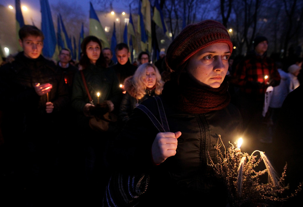 . People light candles during a ceremony to commemorate victims of the 1932-33 Great Famine in Kiev, Ukraine, Saturday, Nov. 23, 2013. Ukraine marks the 80th anniversary of the terrible famine of 1932-33 in which millions of Soviet citizens perished.(AP Photo/Sergei Chuzavkov)