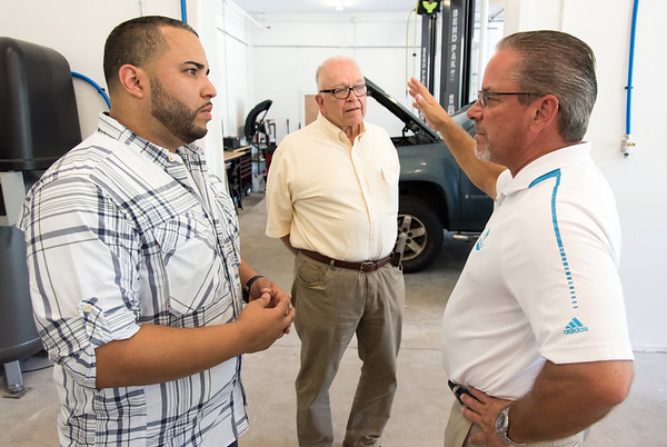 08/29/18 Wesley Bunnell | Staff J's Auto Sales and Repair LLC located at 866 West Main St in New Britain held a ribbon cutting for their official opening on Wednesday afternoon. Owner Jesus Ruiz, L, speaks with President of the Greater New Britain Chamber of Commerce Tim Stewart as Alderman Don Naples looks on.