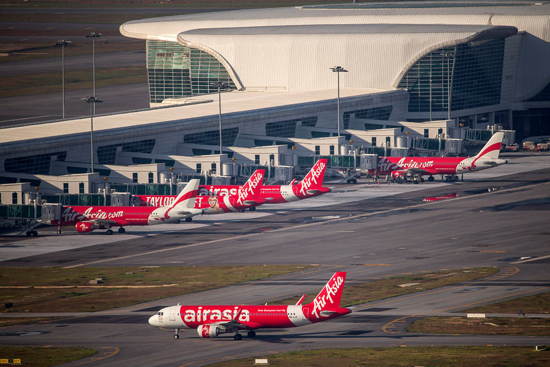 . In this Nov 26, 2014 photo, AirAsia Airbus A320-200 passenger jets are seen on the tarmac at low cost terminal KLIA2 in Sepang, , Malaysia. An AirAsia plane with 161 people on board lost contact with ground control on Sunday, Dec. 28, 2014, while flying over the Java Sea after taking off from a provincial city in Indonesia for Singapore, and search and rescue operations were underway. The planes in this photo are not the plane that went missing while flying from Indonesia to Singapore but one of the same models. (AP Photo/Vincent Thian)