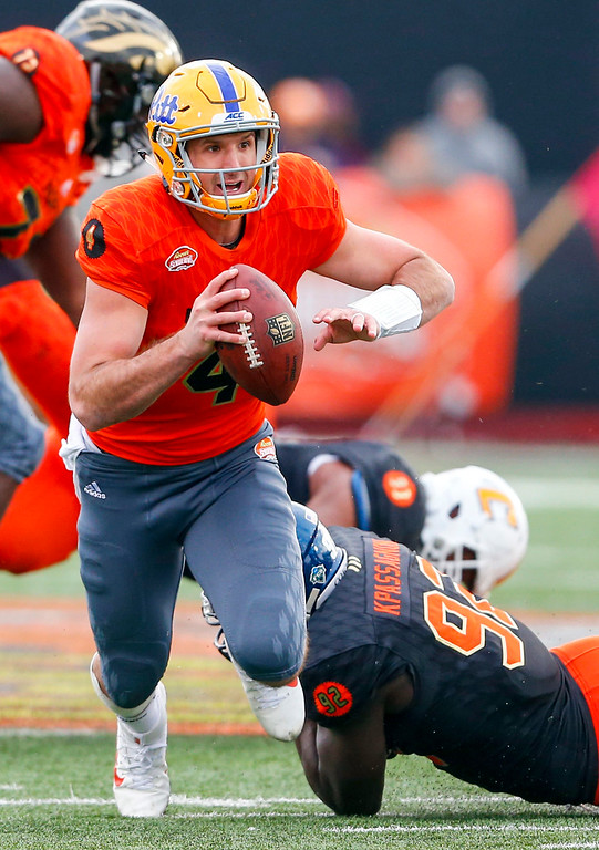 . North squad quarterback Nate Peterman (4), of Pittsburgh, is tripped and tackled by South squad defensive end Tanoh Kpassagnon (92), of Villanova, as he scrambles during the second half of the Senior Bowl NCAA college football game, Saturday, Jan. 28, 2017, in Mobile, Ala. (AP Photo/Butch Dill)