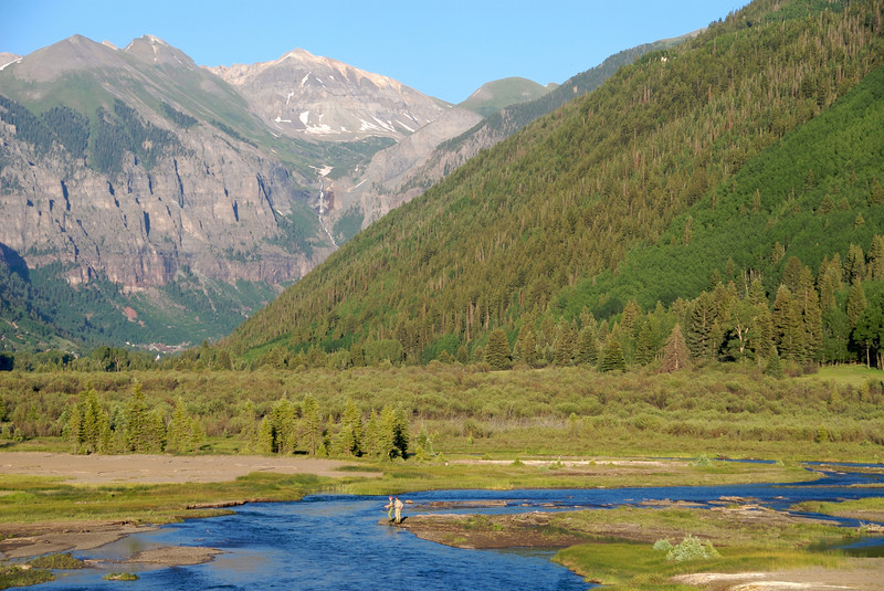 a woman fly fishing with a guide on the San Miguel river outside of Telluride Colorado