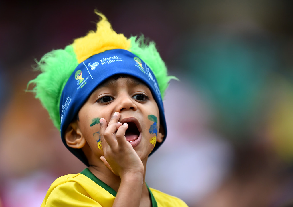 . A fan cheers prior to the 2014 FIFA World Cup Brazil Group A match between Croatia and Mexico at Arena Pernambuco on June 23, 2014 in Recife, Brazil.  (Photo by Jamie McDonald/Getty Images)