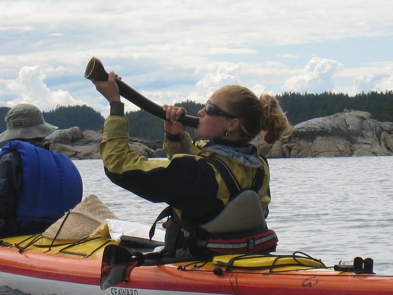 Kate demonstrates a bull kelp horn