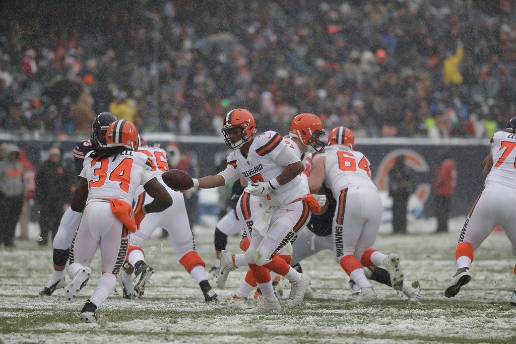 . Cleveland Browns quarterback DeShone Kizer (7) hands off to running back Isaiah Crowell (34) against the Chicago Bears in the first half of an NFL football game in Chicago, Sunday, Dec. 24, 2017. (AP Photo/Nam Y. Huh)