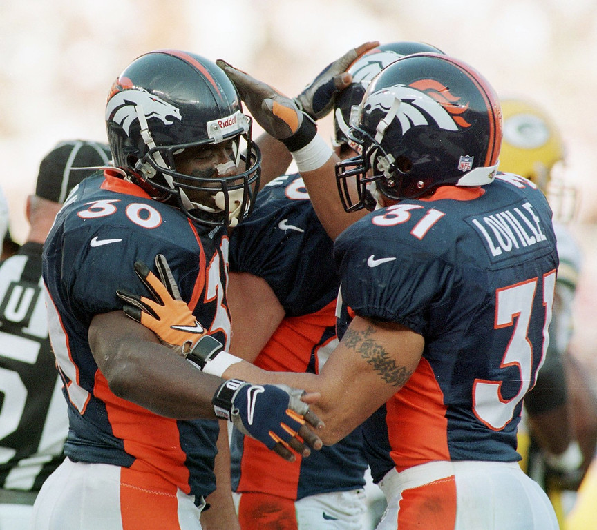 . Denver Broncos Terrell Davis celebrates his first  quarter touchdown with Derek Loville as the Broncos face the  Green Bay Packers in Super Bowl XXXII in San Diego CA.  (Karl Gehring/The Denver Post)