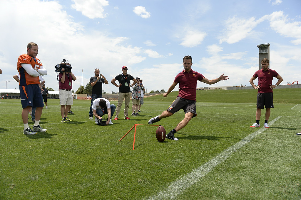 . Denver Broncos kicker Matt Prater (5) watches a member of the AS Roma team kick a field goal after practice. The Roma team visited the Denver Broncos 2014 training camp July 25, 2014 at Dove Valley. (Photo by John Leyba/The Denver Post)