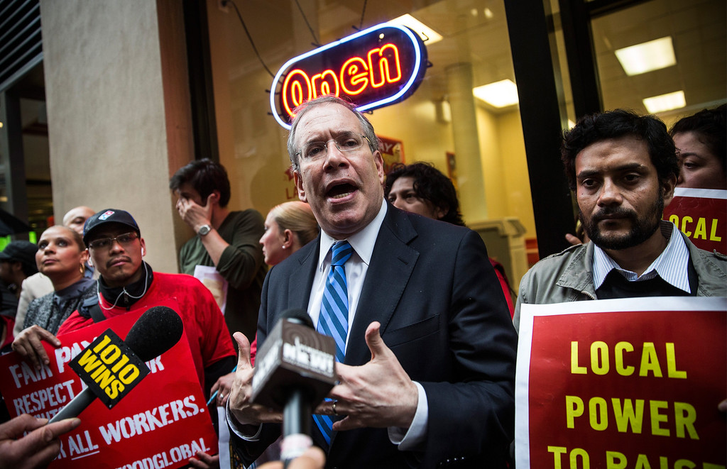 . New York City Comptroller Scott Stringer speaks to protesters demanding higher wages for fast food workers during a massive rally outside a Domino\'s Pizza store on May 15, 2014 in New York City.   (Photo by Andrew Burton/Getty Images)