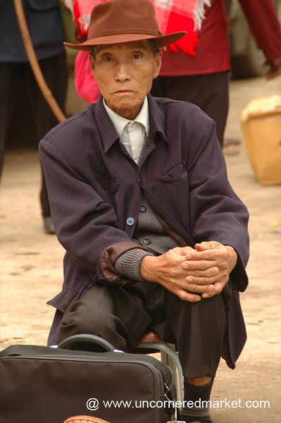 Man at Menghun Market - Xishuangbanna, China
