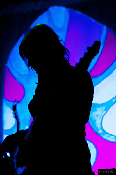 Silhouetted Shonna Tucker of the Drive-By Truckers Go-Go Boots Tour The Ogden Theatre March 18, 2011