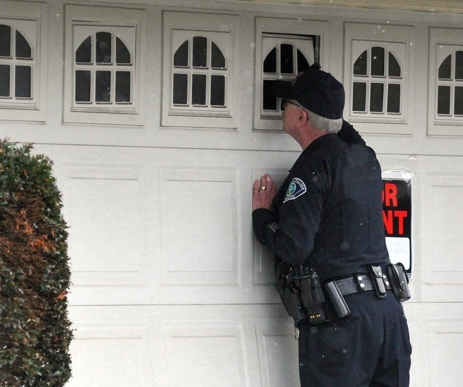 . La Palma Police Officers check a vacant home near what is believed to be Christopher Dorner\'s mother\'s La Palma home as FBI computer recovery task force investigators armed with a search warrant go through a computer on Friday February 8, 2013. Various agencies have arrived to lend assistance at the home. (SGVN/Staff Photo by Keith Durflinger)