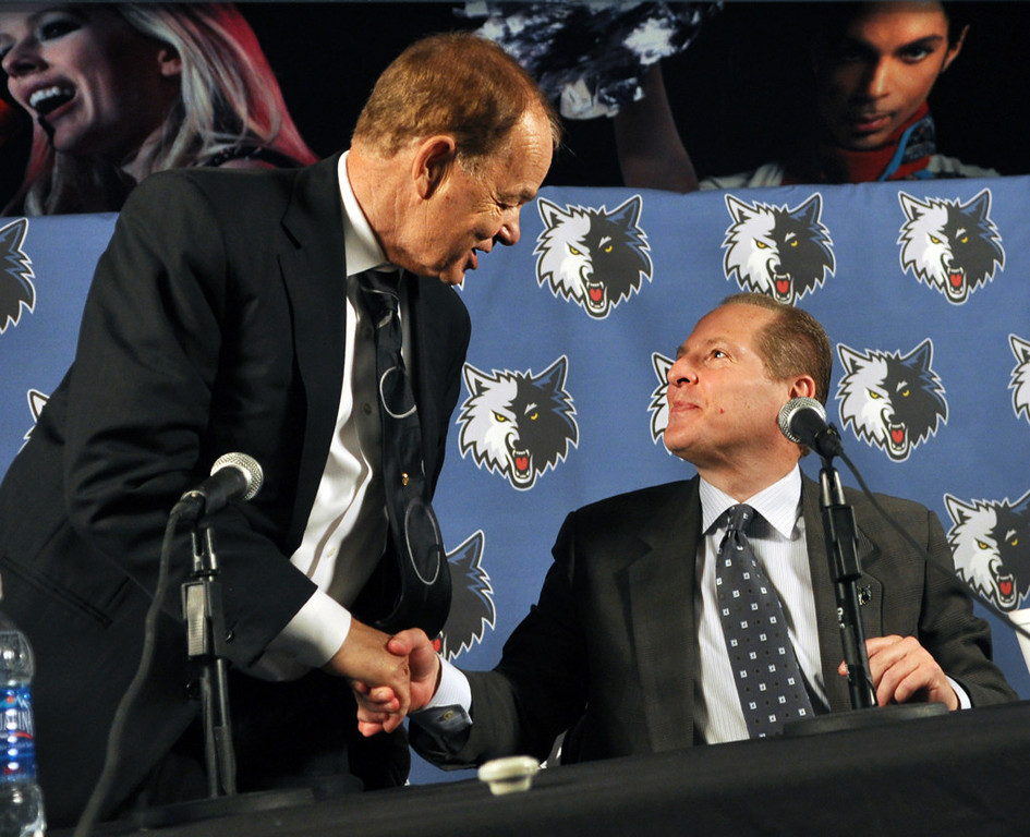 . David Kahn, right, shakes hands with team owner Glen Taylor after a press conference announcing his appointment as president of basketball operations at Target Center in Minneapolis on May 22, 2009.   (Pioneer Press: Ben Garvin)